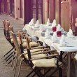 Romantic cafe terrace with empty tables and chairs on street in — Stock Photo #52403561