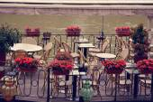 Empty outdoor summer cafe tables and chairs near the river in Pa — Stock Photo