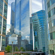 District La Defense on August 20, 2014 in Paris. It is Europes largest business district with 560 hectares area 72 glass and steel buildings and skyscrapers — Stock Photo #53809577