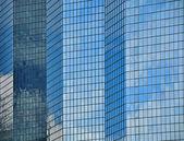 Glass facade of modern city buildings — Stok fotoğraf