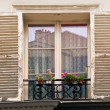 Old typical European window with open wooden shutters — Stock Photo #56205769