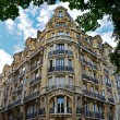 Facade of typical house with balcony in Paris. City, urban view on building in Paris, France — Stock Photo #56205773
