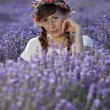 Relaxing woman in lavender field — Stock Photo #56378203