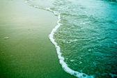 Sea foam on a beach — Foto de Stock
