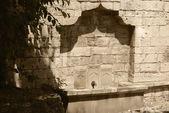 Water tap in a fortification wall.Kalemegdan. — Stock Photo