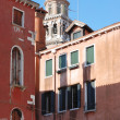 View of a bell tower and houses in Venice. — Stock Photo #69382193