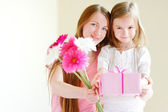 Mother and  daughter giving   gift — Stock Photo