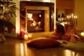 Girl near fireplace — Stock Photo
