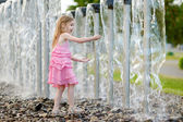 Girl playing with fountain — Stock Photo