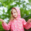 Girl  standing under  rain — Stock Photo #51964565
