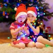Sisters decorating Christmas tree — Stock Photo #52247493