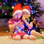 Sisters decorating Christmas tree — Stock Photo #52247493