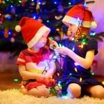Sisters decorating Christmas tree — Stock Photo #52247497
