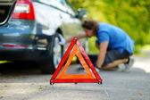 Warning triangle  on  road — Stock Photo