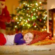Girl sleeping under Christmas tree — Stock Photo #52801983
