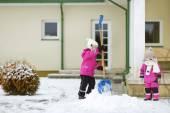 Little sisters on snowy winter day — Fotografia Stock