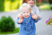 Little sisters having fun on summer day — Stock Photo