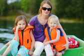 Mother and little daughters on boat — Foto Stock