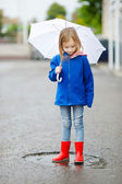 Adorable little girl with umbrella — Stock Photo