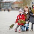 Girls and mother with  Easter willow branches — Stock Photo #61293431