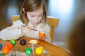 Little girl coloring Easter egg — Stock Photo
