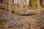 Little girl in forest — Stock Photo