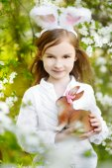 Little girl wearing Easter bunny ears — Stock Photo