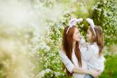 Mother and daughter in Easter bunny ears — Stock Photo