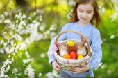 Adorable girl with basket of Easter eggs — Foto de Stock