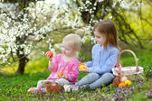 Little sisters playing with Easter eggs — Stock Photo