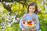 Little girl Easter basket with eggs — Stock Photo