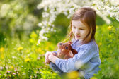 Little girl with easter bunny — Stock Photo