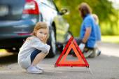 Girl with red warning triangle sign — Stock Photo