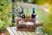 Wine bottles in vintage wooden crate — Stock Photo