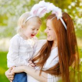 Mother and daughter wearing bunny ears — Stock Photo