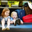 Little sisters sitting in car — Stock Photo #65471475
