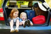 Little sisters sitting in car — Stock Photo