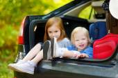 Little sisters in car — Stock Photo