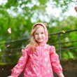 Adorable girl under the rain — Stock Photo #66730211