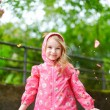 Adorable little girl under rain — Stock Photo #66731539