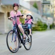Young mother and toddler girl on bicycle — Stock Photo #66732569