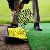 Man with Yellow golf balls — Stock Photo