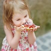 Little girl with strawberry tart — Stock Photo