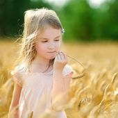 Adorable girl in wheat field — Stock Photo
