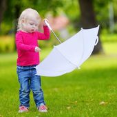 Girl playing with white umbrella — Stock Photo