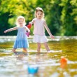 Two sisters with paper boats — Stock Photo #68759697