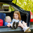 Little sisters sitting in car — Stock Photo #68759789