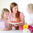 Daughters and mother on birthday — Stock Photo #68759933