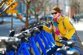 Woman near bikes for rent — Foto de Stock