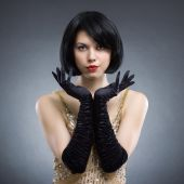 Woman with stylish hairstyle and black gloves — Stock Photo